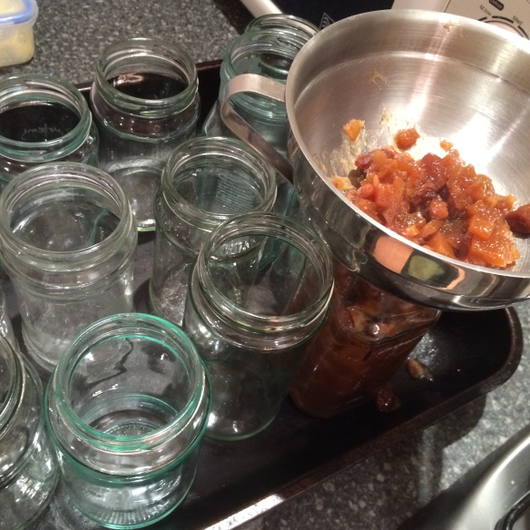bottling chutney with funnel